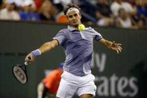 12 March 2014 Roger Federer of Switzerland returns a shot against Tommy Haas of Germany during the